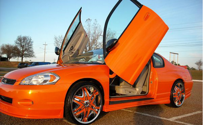 rides 2006 chevrolet monte carlo chevy featured-hp orange lambo orange rims spinners lambo doors souped-up donk box bubble